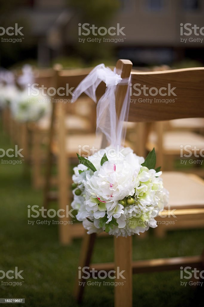 Wedding chairs decorated with flowers stock photo
