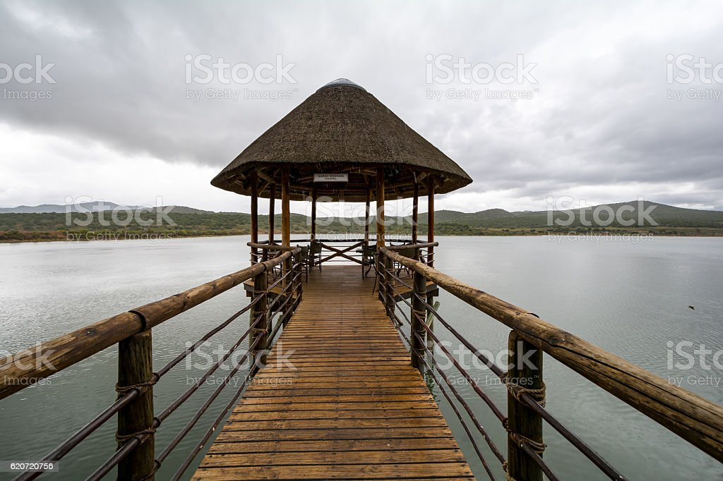 Wedding Chapel on a lake with a cloudy Background stock photo
