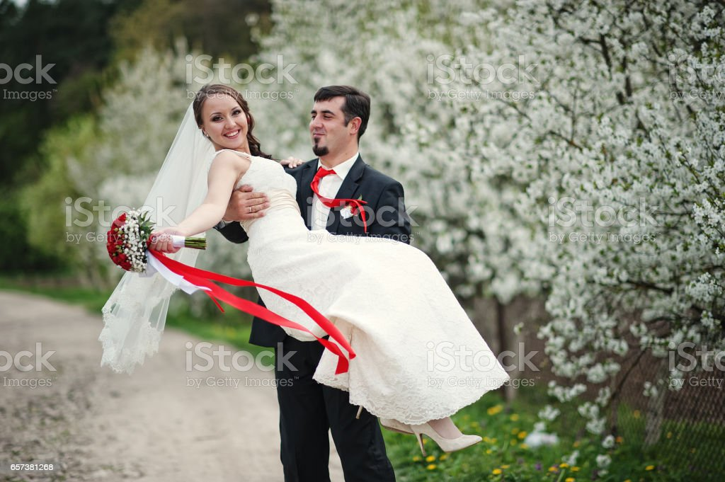 wedding couple at spring flowering and blossom cherries tree stock photo