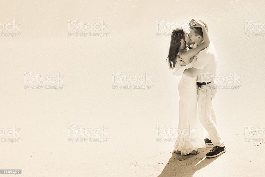 wedding couple at the beach stock photo