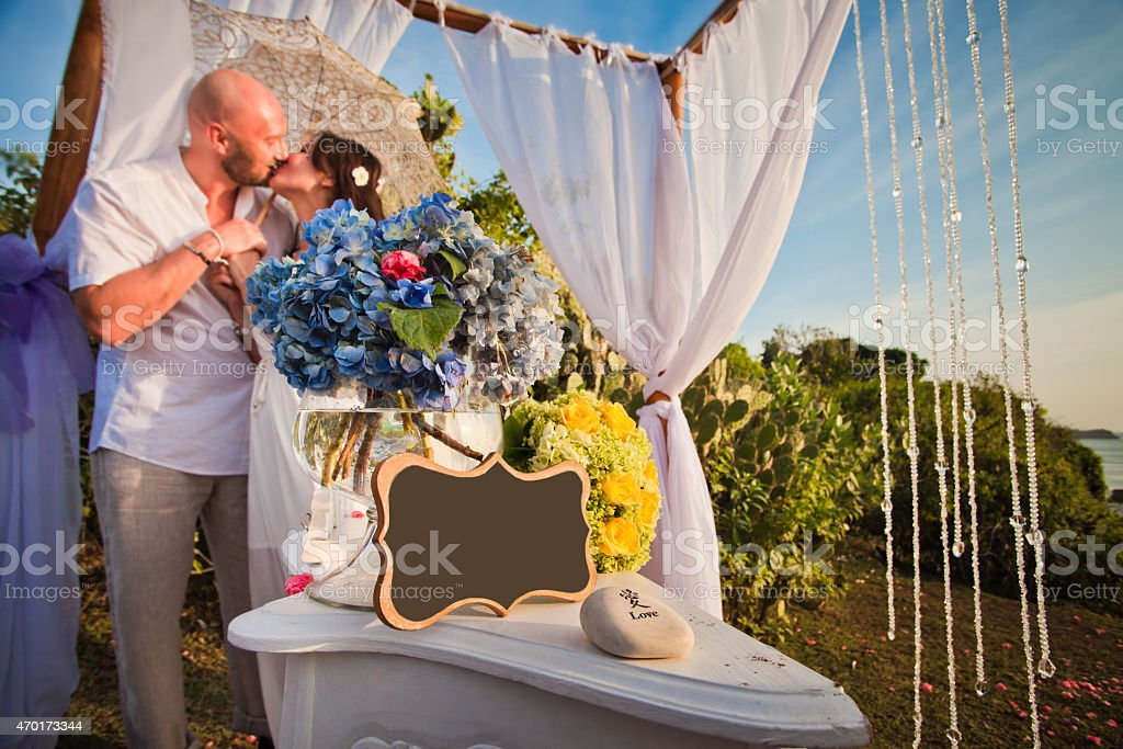 wedding couple at the beach with frame stock photo