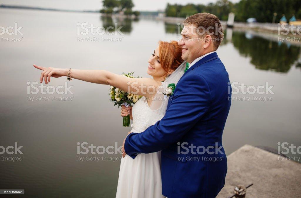 Wedding couple background lake on cloudy day. stock photo