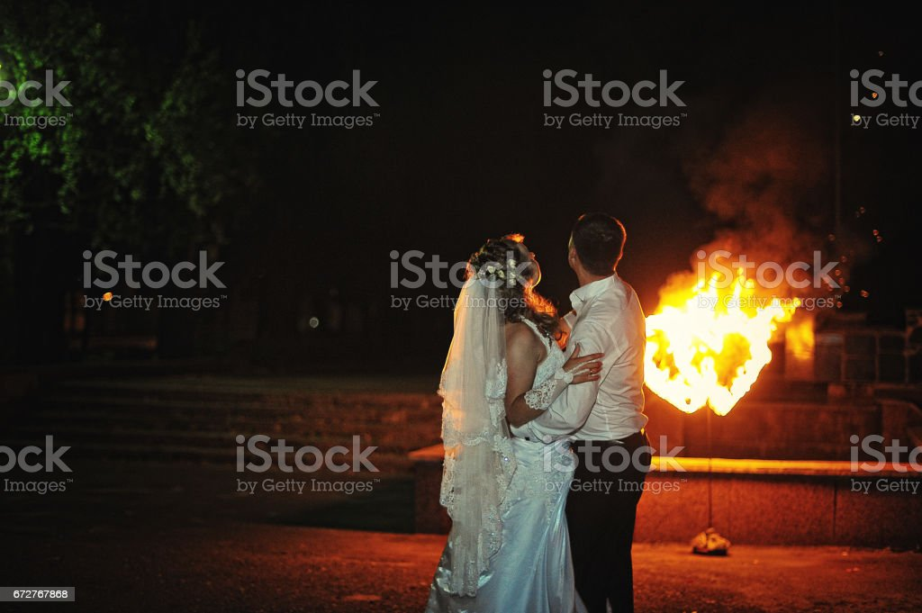 wedding couple background two fire heart stock photo