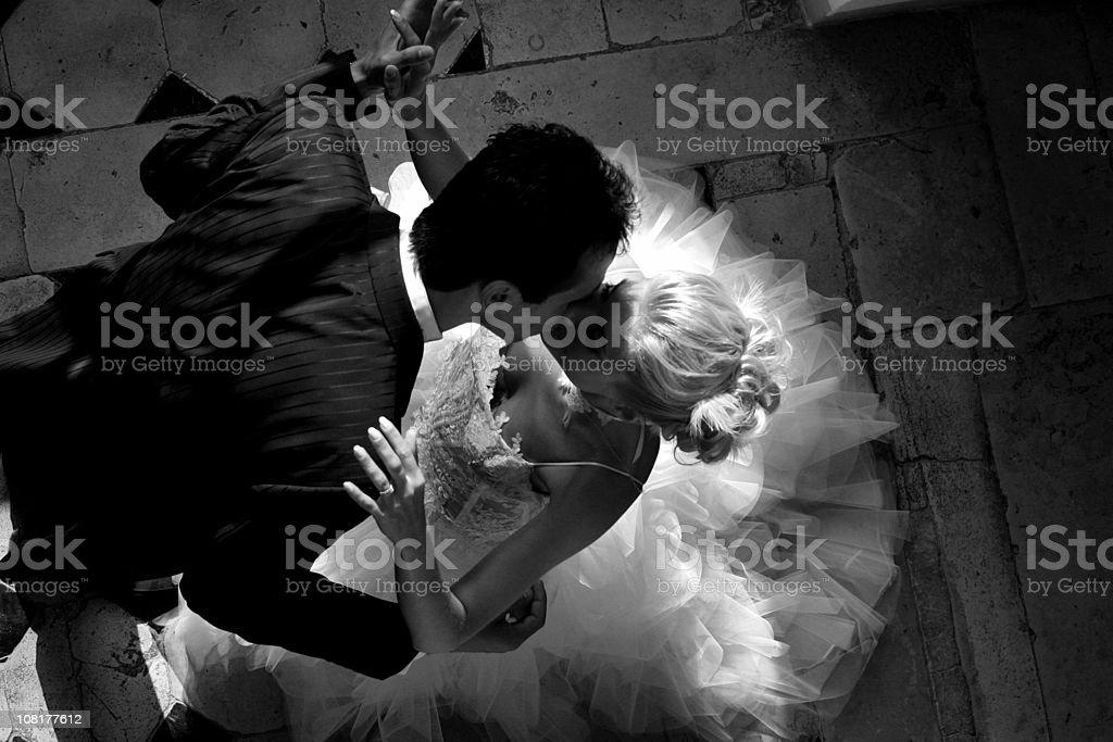 Wedding couple dancing and Kissing stock photo