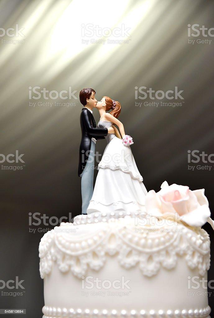 Wedding Couple Figure on the Cake stock photo