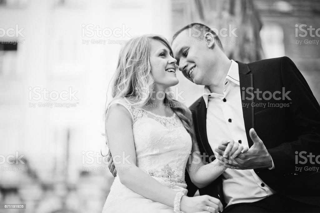 wedding couple holding hands close up stock photo