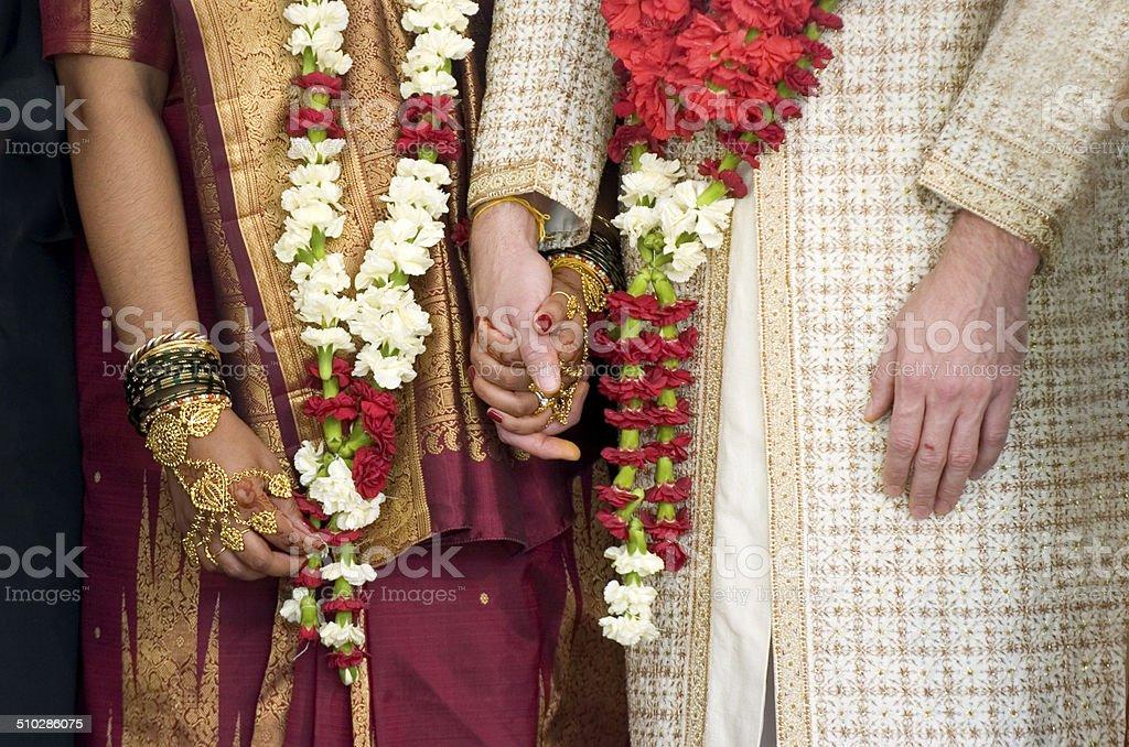 Wedding couple holding hands stock photo