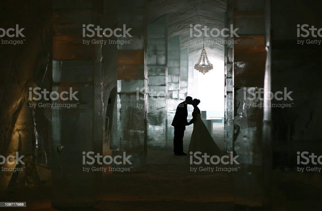 wedding couple kiss at the ice hotel, Kiruna, Sweden stock photo