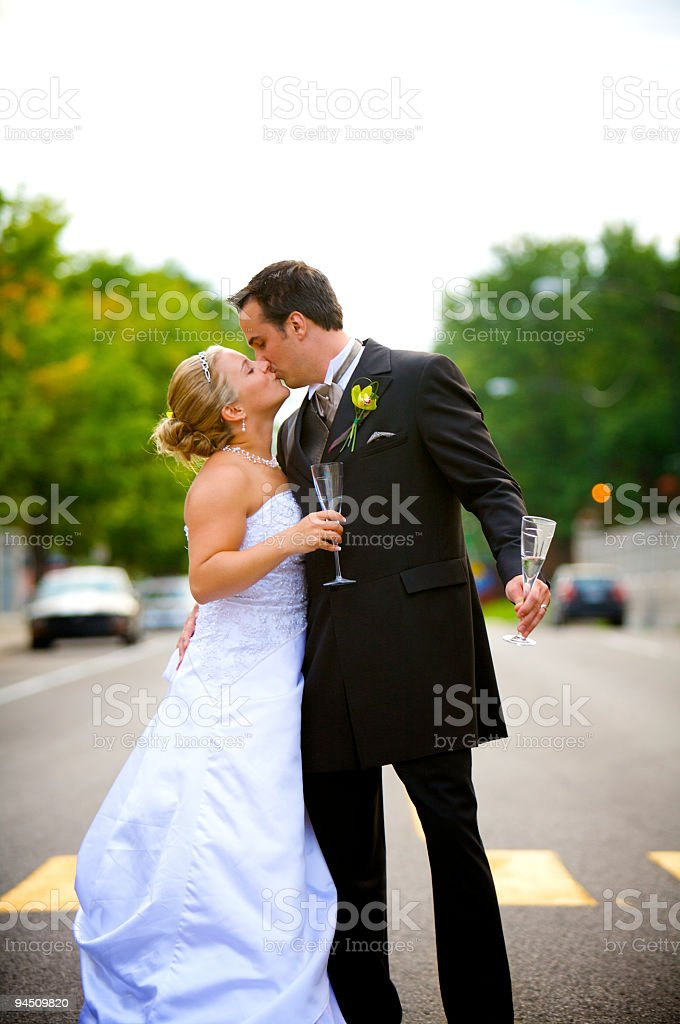 wedding couple kissing in the street royalty-free stock photo