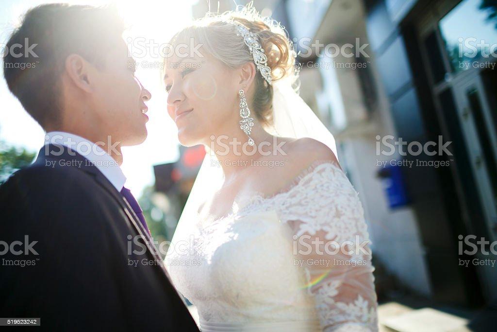 Wedding couple lens flare stock photo