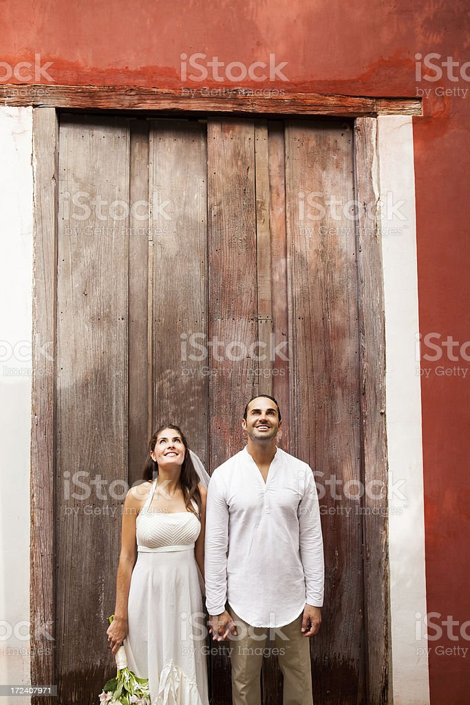 Wedding couple looking up royalty-free stock photo