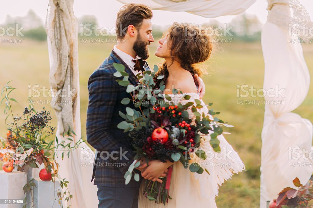 Wedding couple lovingly look at each other during  ceremony stock photo