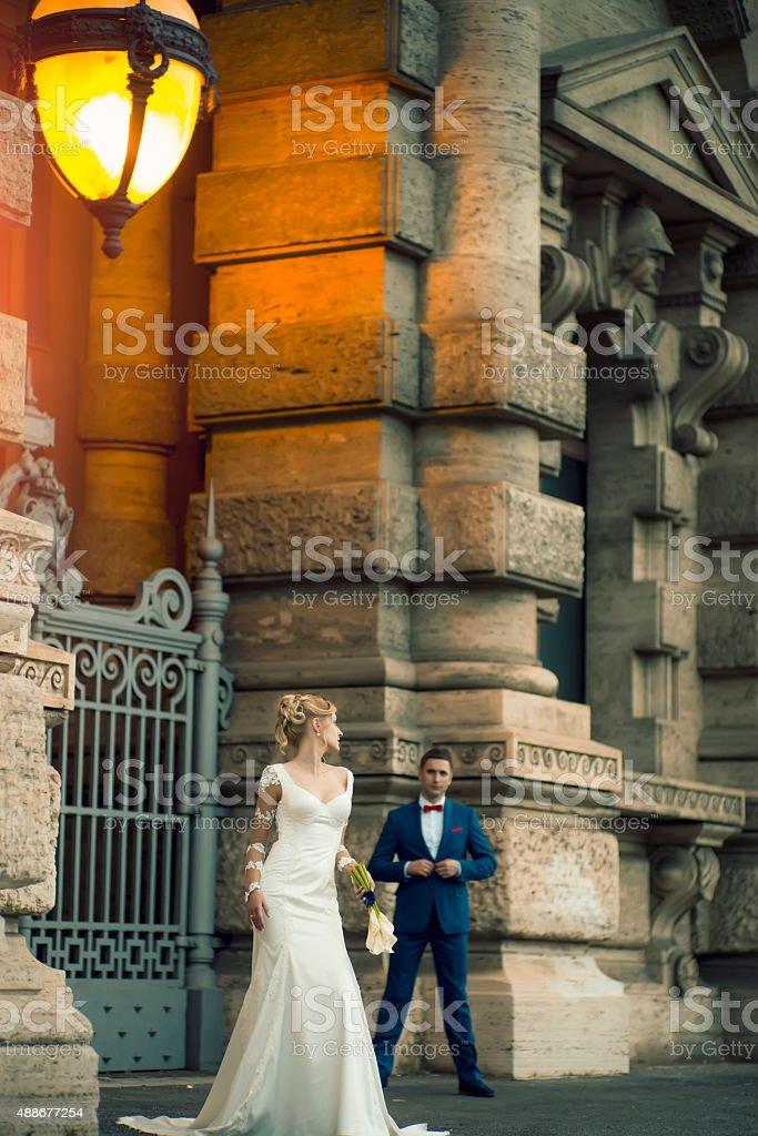 Wedding couple near stone building stock photo