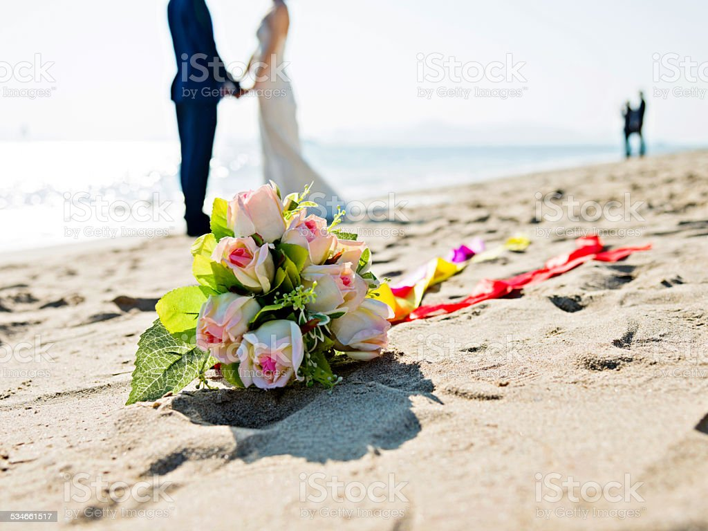Wedding couple on beach stock photo