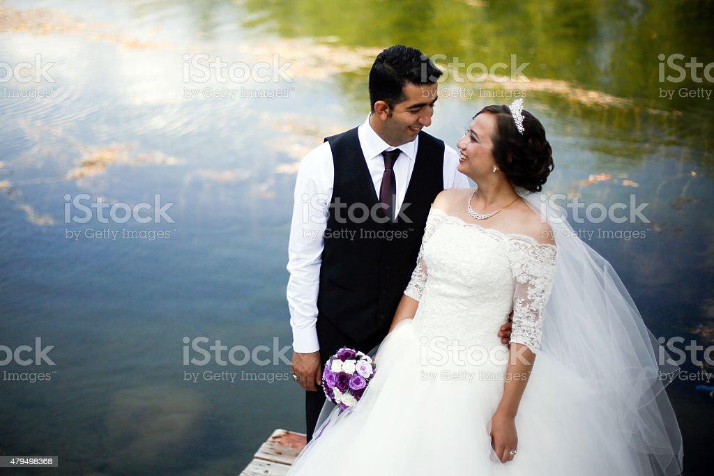 wedding couple on dock stock photo