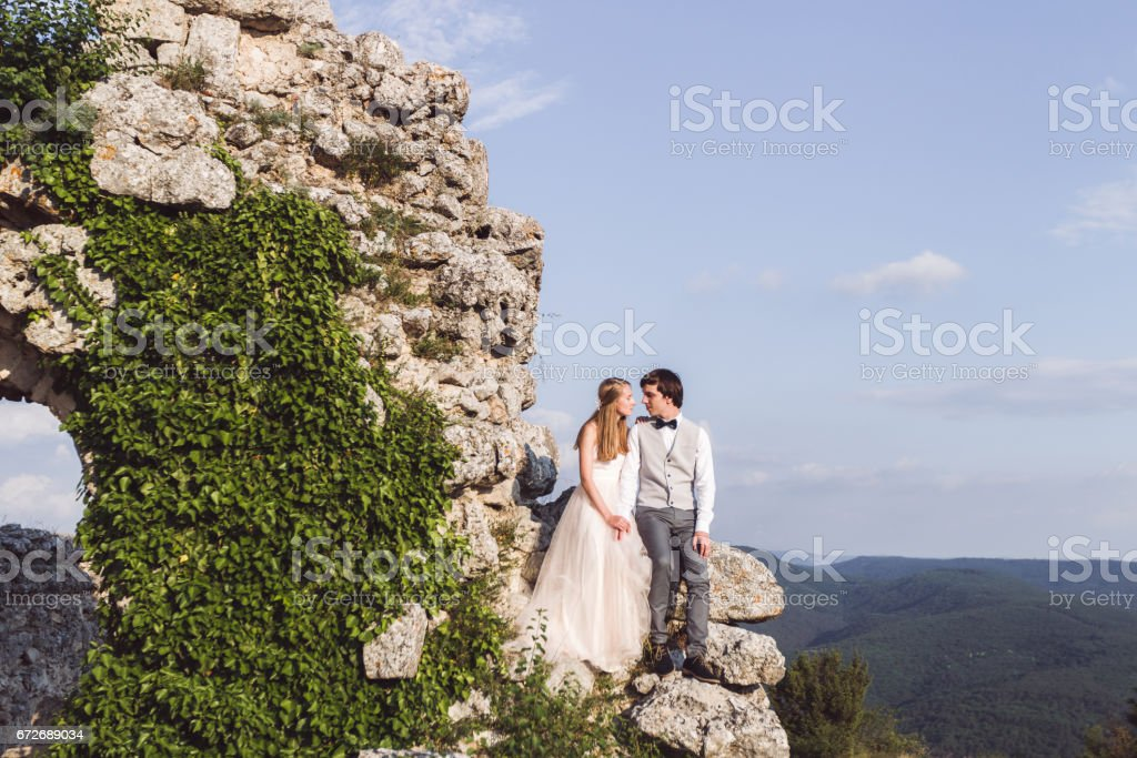 Wedding couple on the wall of fortress stock photo