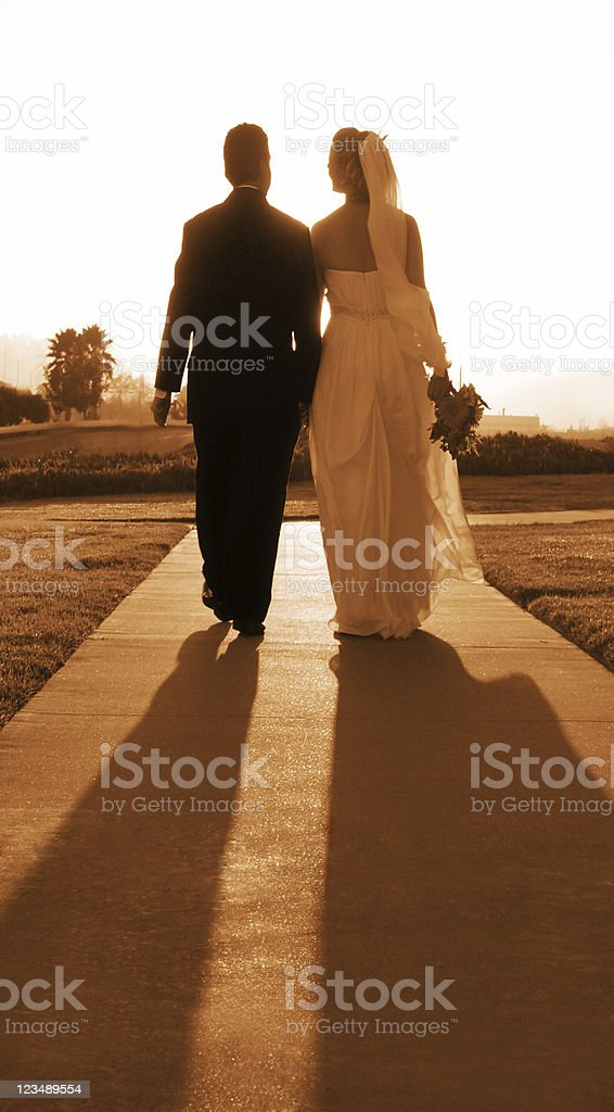 wedding couple walking together stock photo