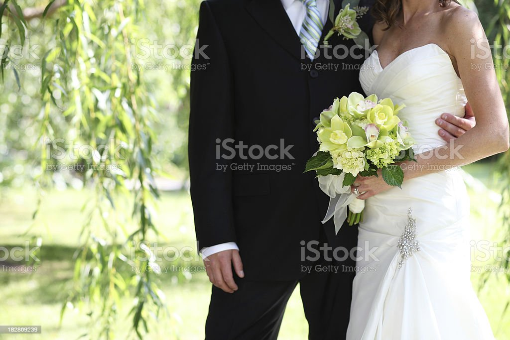 Wedding Couple with Green Orchids royalty-free stock photo