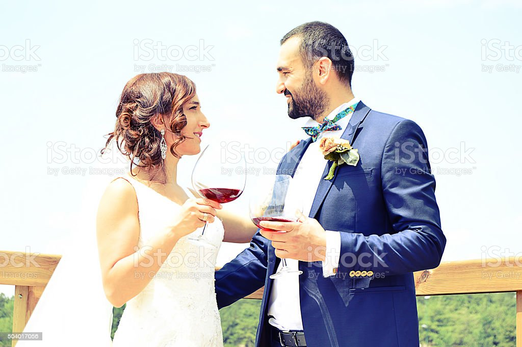 Wedding couple with wine glasses stock photo