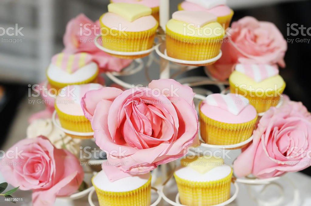 Wedding cupcakes, focus on flower stock photo
