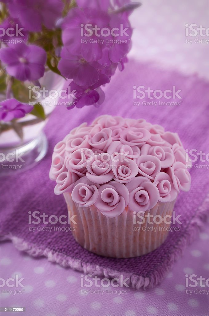 Wedding cupcakes on a pink background stock photo