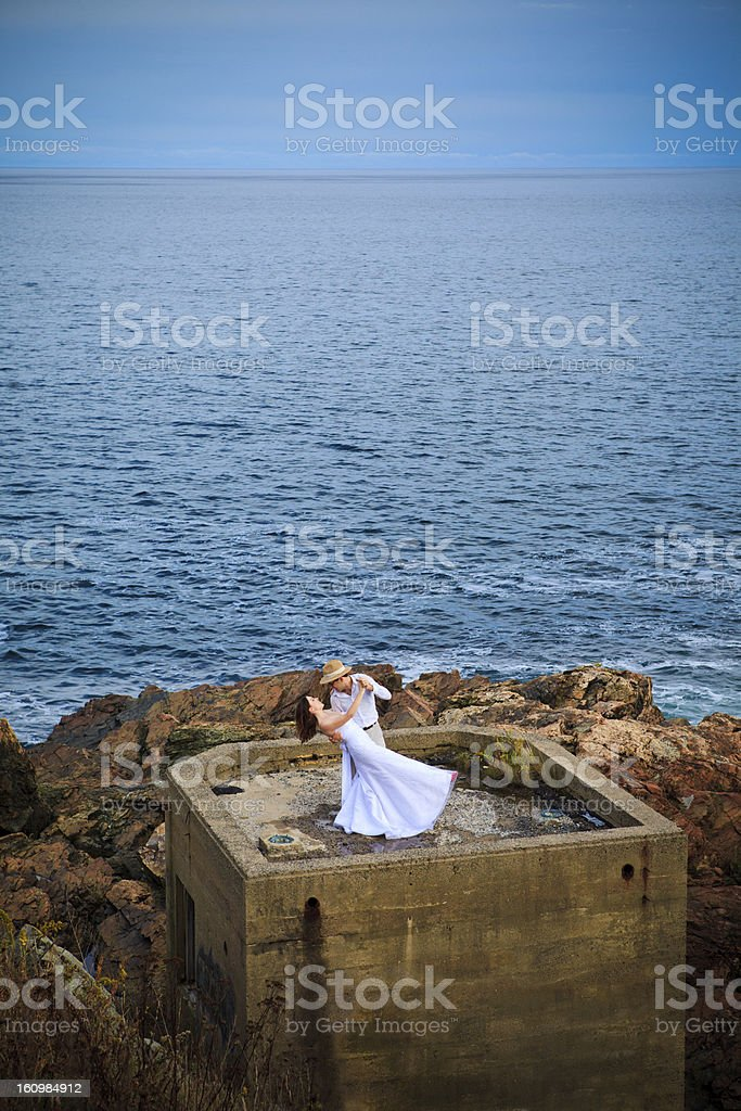Wedding dance at blue hour on concrete bunker royalty-free stock photo