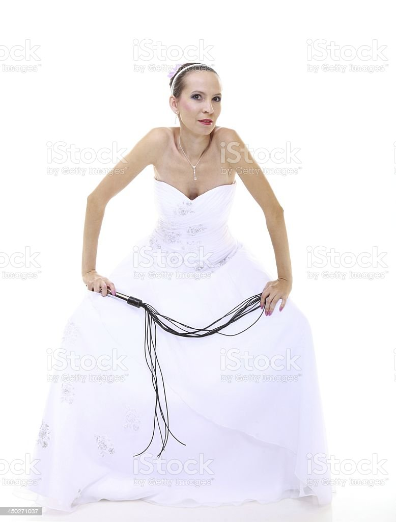 Wedding day. Bride with black flogging whip isolated stock photo