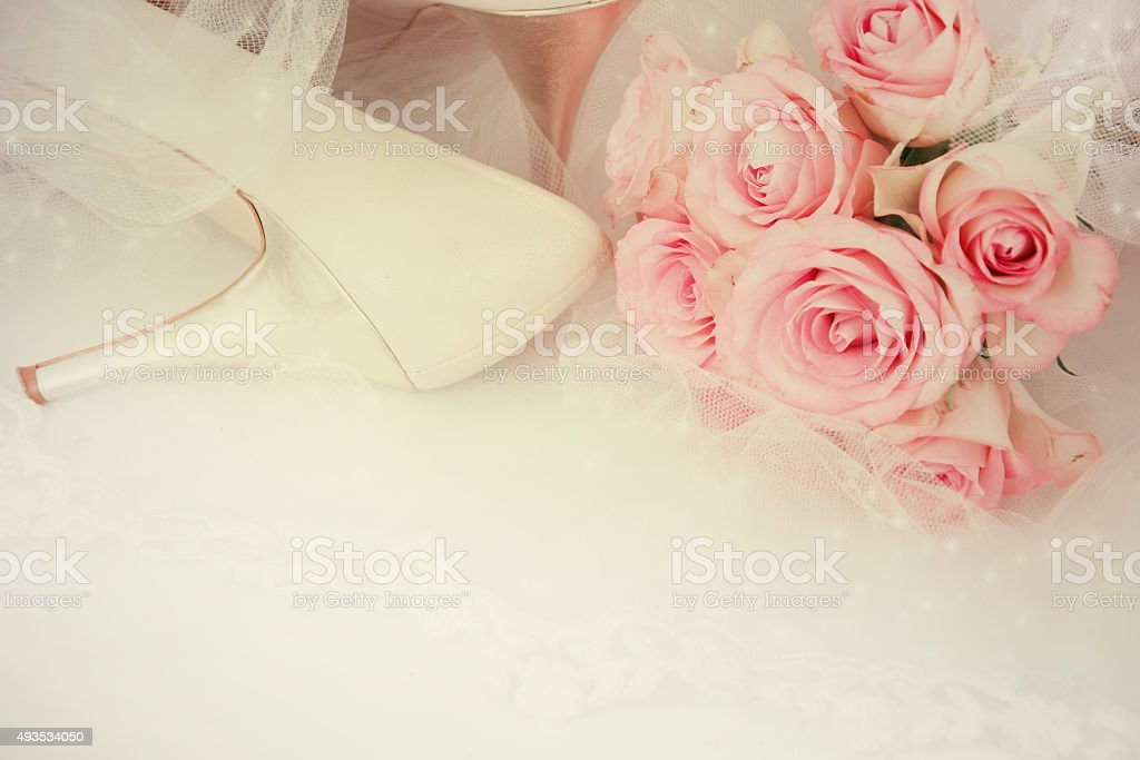 Wedding Day concept with roses and bridal shoes. stock photo
