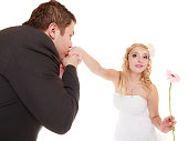 Wedding day. groom kissing hand of bride isolated