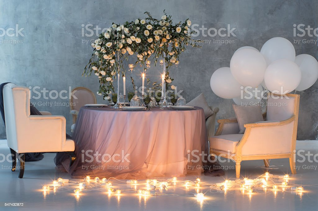 Wedding decoration with roses, lamps and balloons stock photo