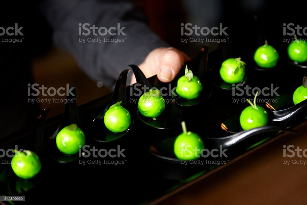 Wedding dessert. Chocolates in the form of small green apples stock photo