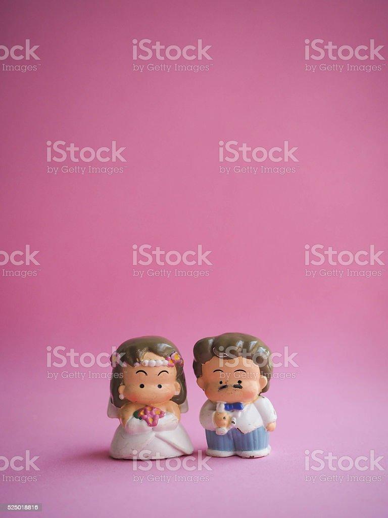 Wedding doll on pink background stock photo