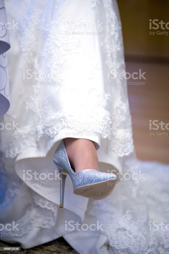 Wedding Dress and Shoes in Women Leg stock photo
