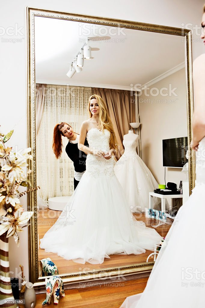 Wedding dress fitting in bridal boutiqe stock photo