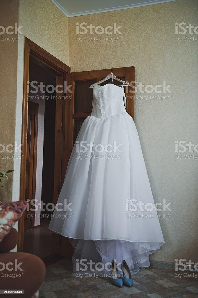 Wedding Dress Hanging On The Door Royalty Free Stock Photo