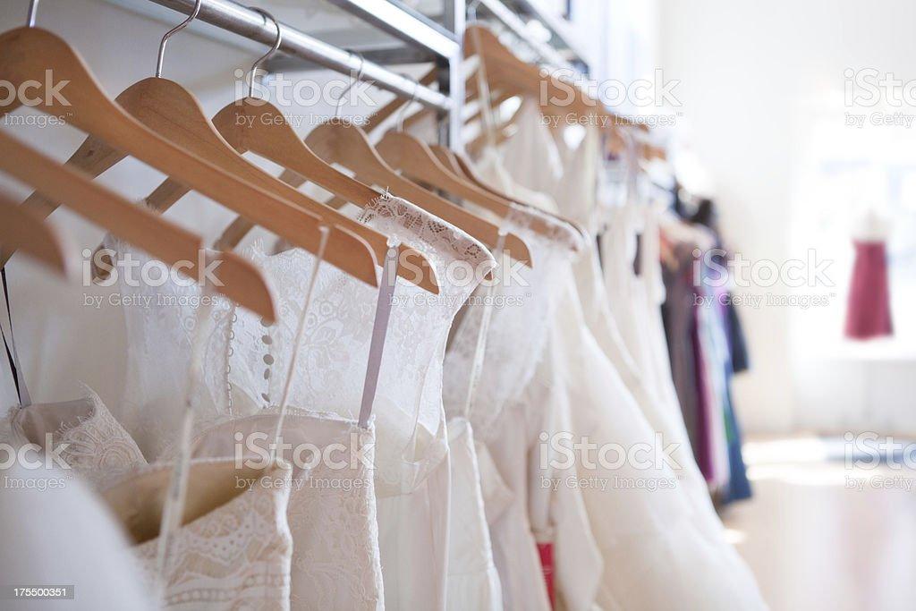 Wedding Dress Selection on Hangers stock photo