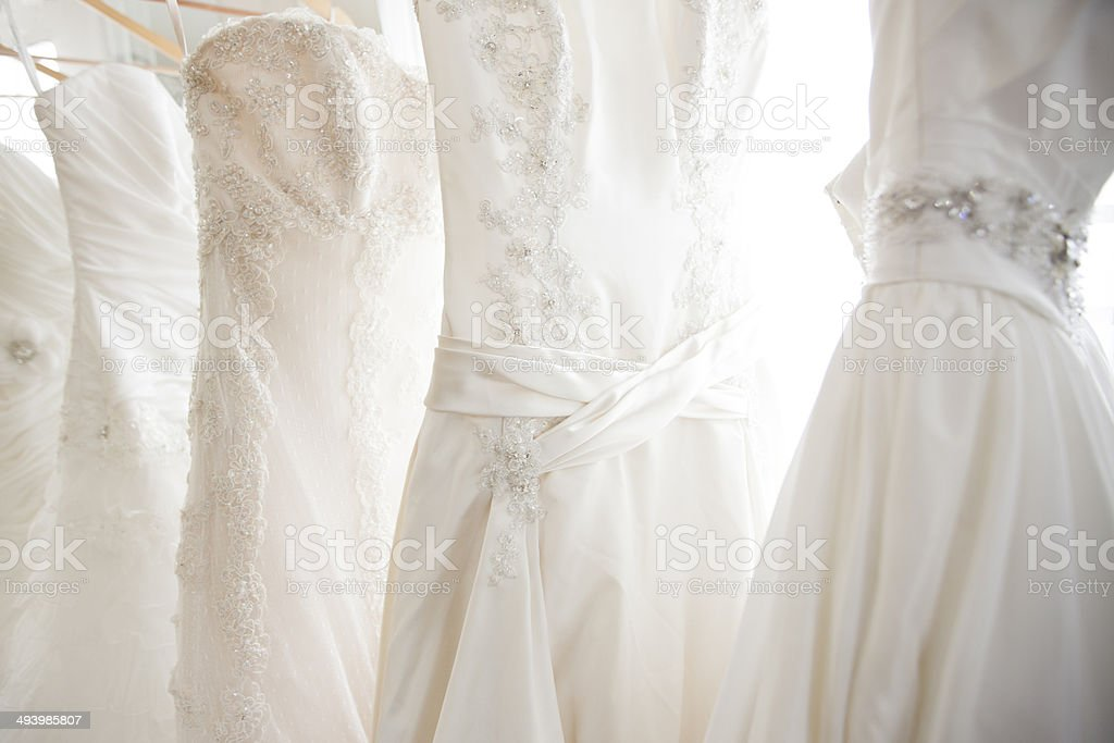 Wedding dresses in a bridal shop stock photo
