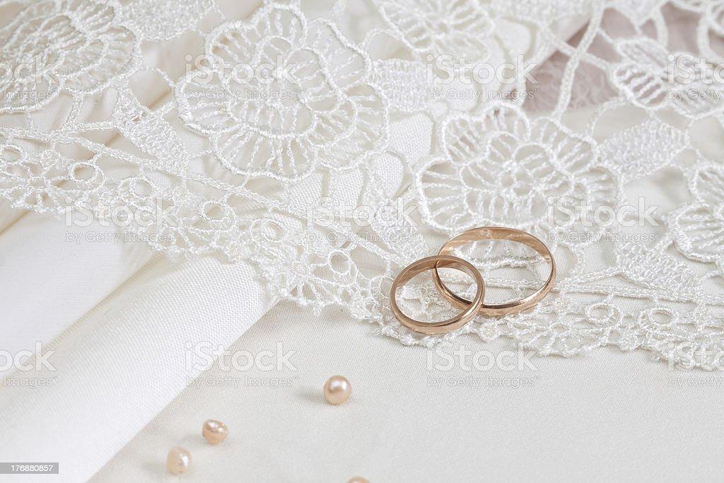 Wedding fabrics and rings royalty-free stock photo