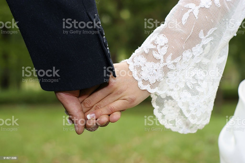 Wedding feelings. Couple holding hands. royalty-free stock photo
