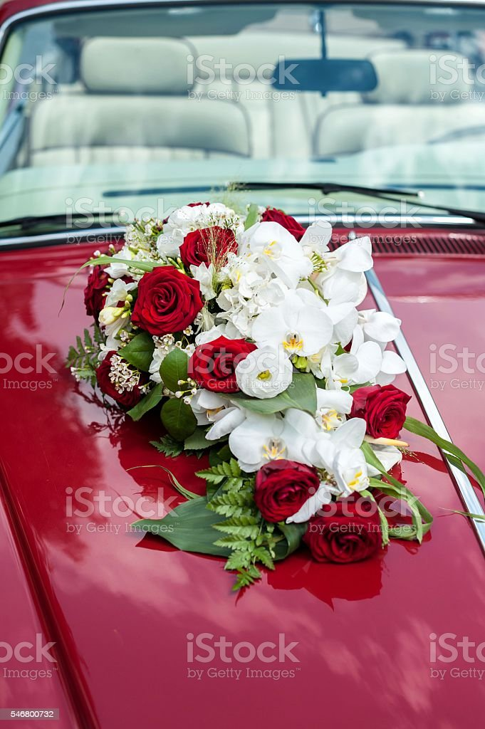 Wedding floral decoration on red car stock photo