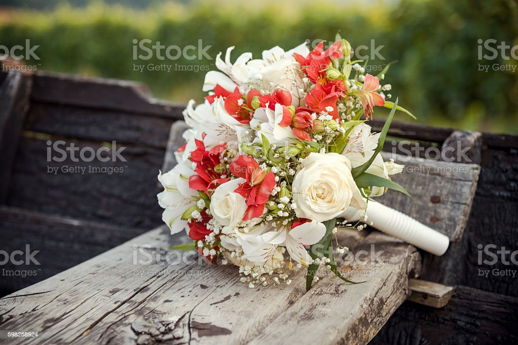 Wedding flower bouquet lying on a wooden surface stock photo