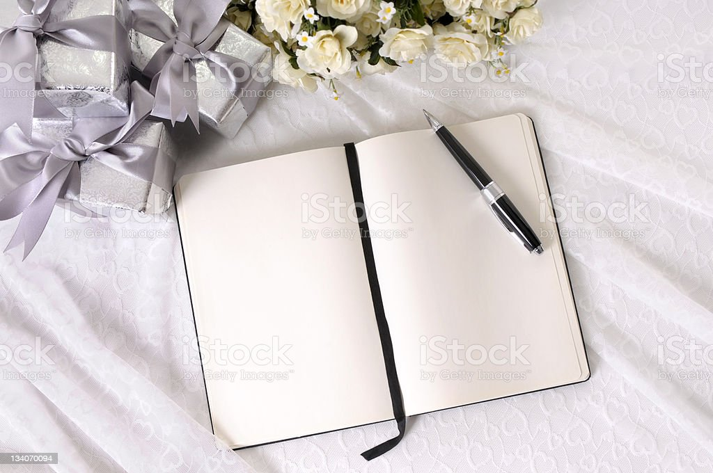 Wedding gifts and writing book stock photo