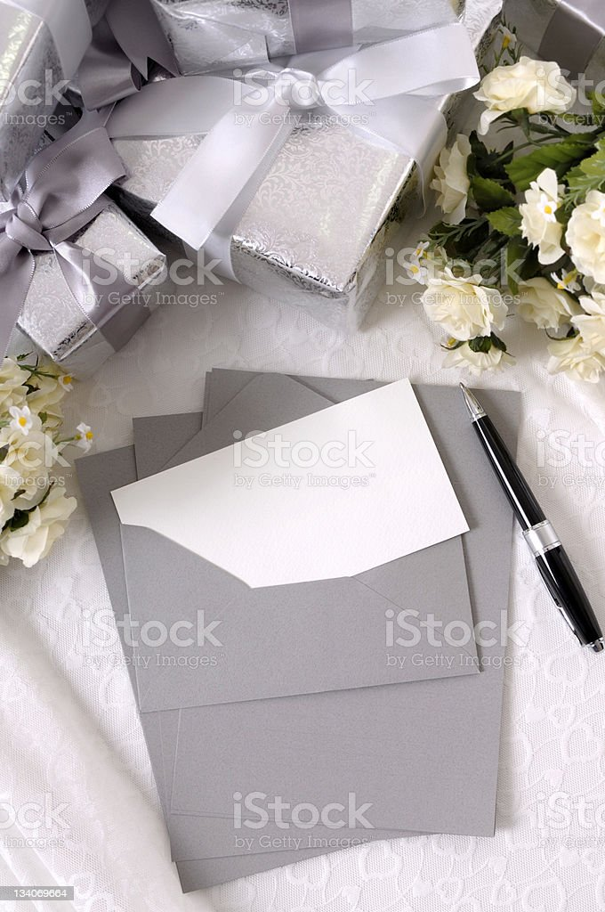 Wedding gifts with invitation or thank you card royalty-free stock photo