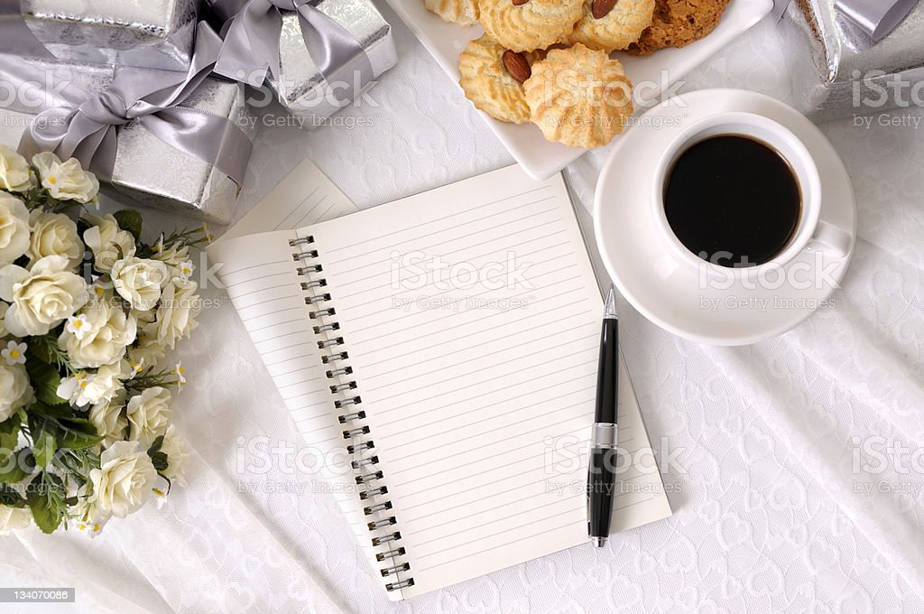 Wedding gifts with notebook and coffee stock photo