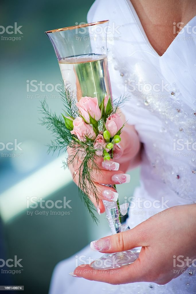 wedding glass in hands of bride royalty-free stock photo
