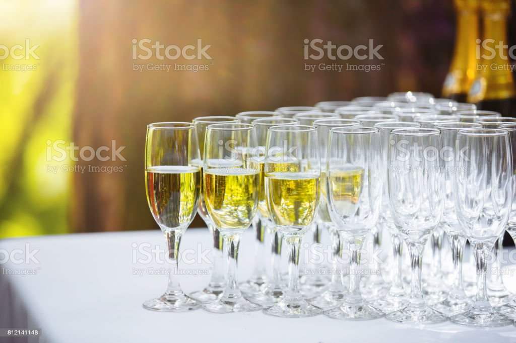 Wedding glasses with champagne on the table. Wedding decoration stock photo