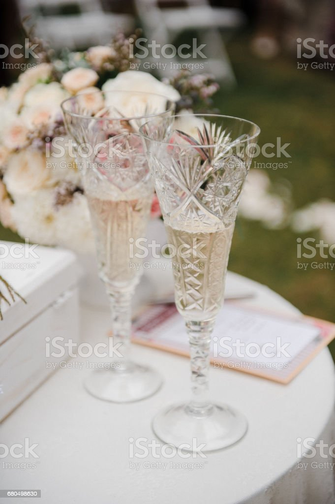 Wedding glasses with champagne. Wedding A box for rings. Wedding...