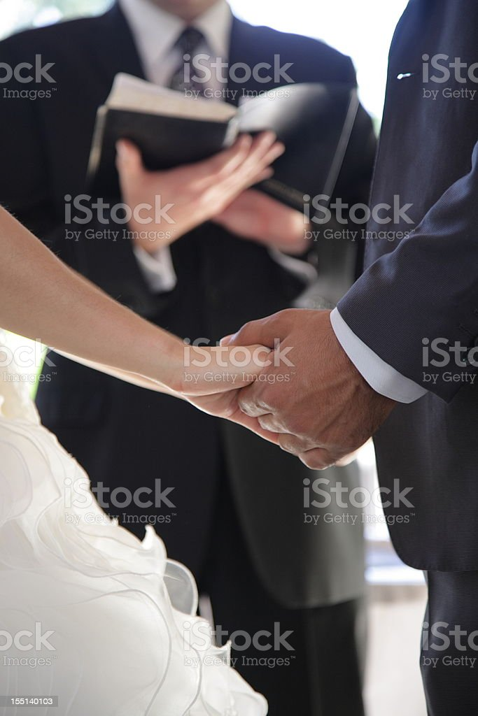 Wedding: Groom and Bride holding hands stock photo