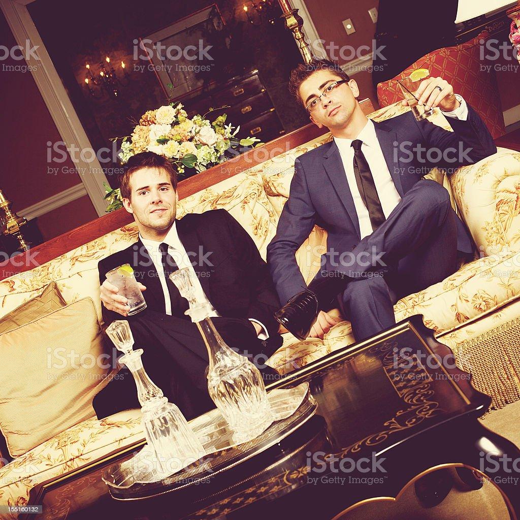 wedding groom groomsman relaxing royalty-free stock photo