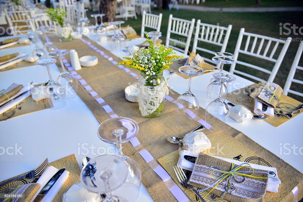 Wedding guest setup with fresh flowers stock photo